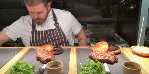 Chef serving plates for Steak Night